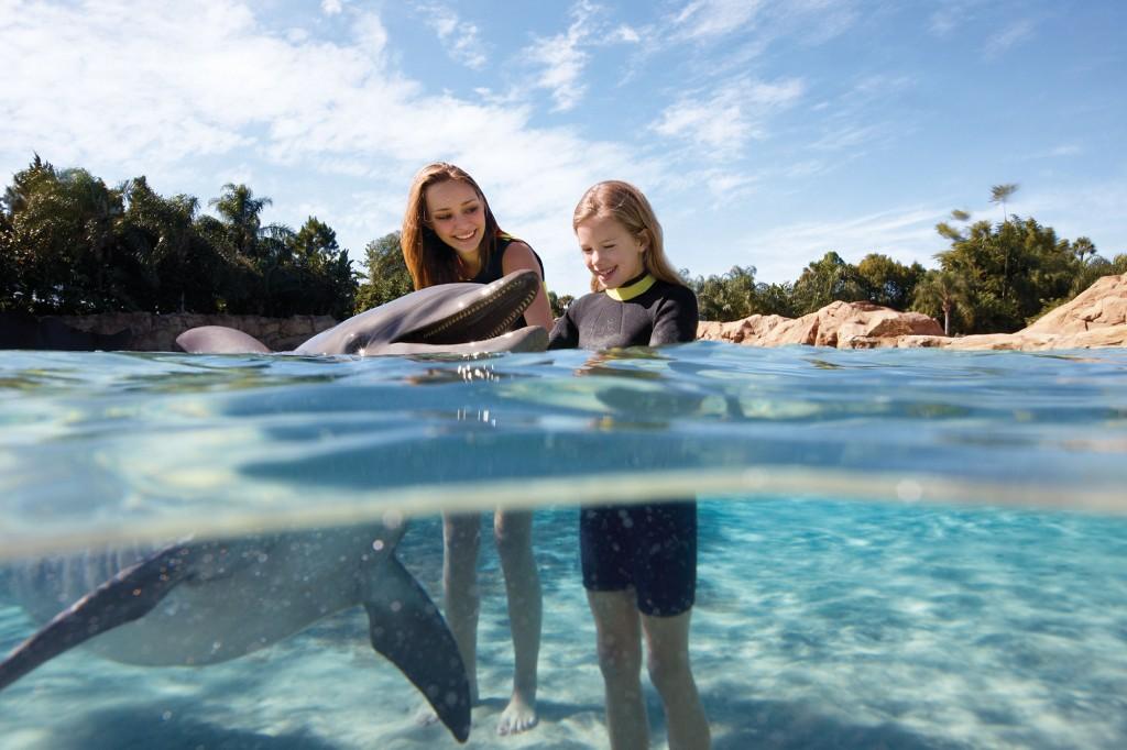 Sisters interacting with dolphin at Discovery Point in SeaWorld San Antonio